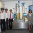Employees of Endress+Hauser Asia Pacific Support Center in front of an exhibition model